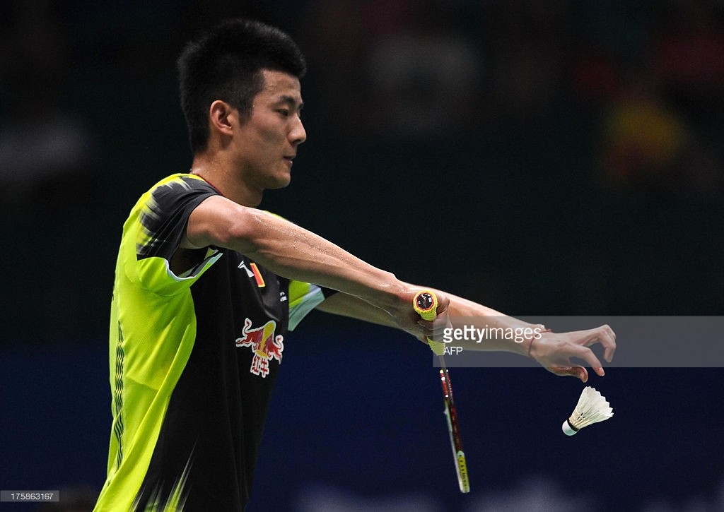 China's Chen Long makes a serve...