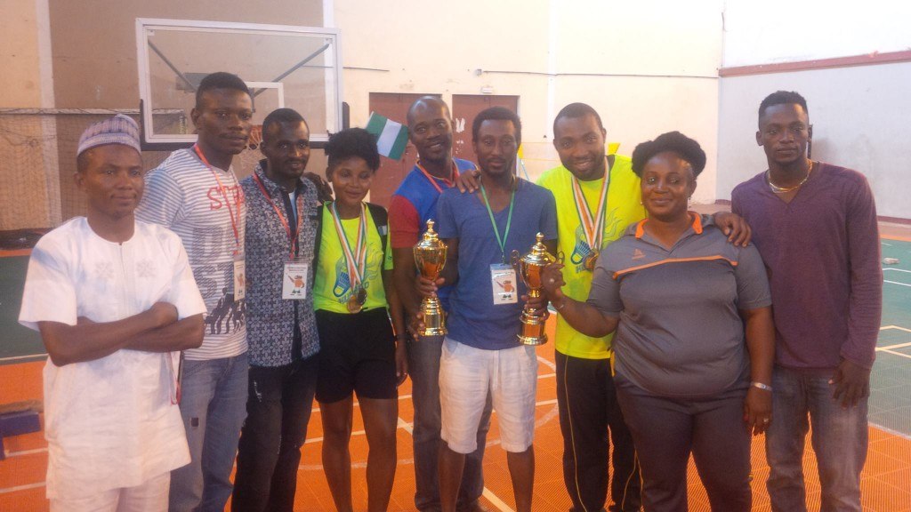 Group of Nigerian players and coaches after triumph
